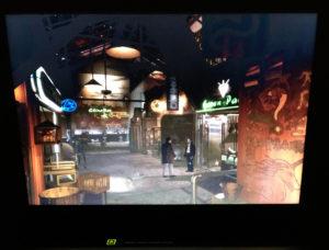 McCoy vernimmt Waffenhändler Izo in der Animoid-Allee